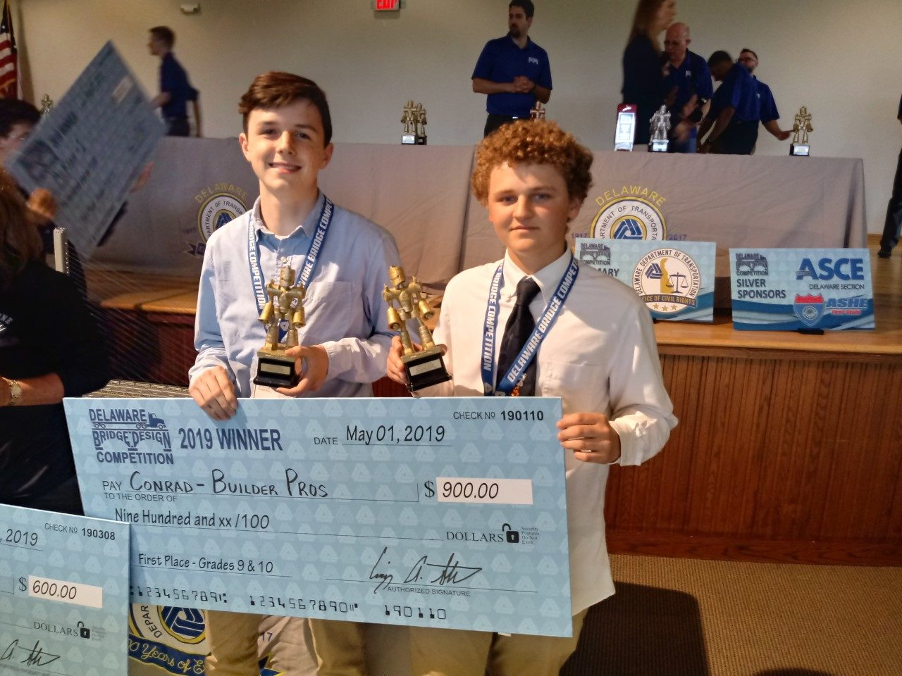 Eli Foester and Aiden Hall at Bridge Builder competition with their $900 check.